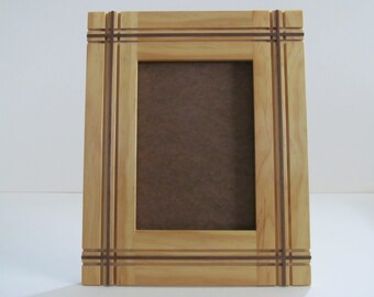Handcrafted 5x7 picture frame with in-lay and grooves.  Includes hardware, glass and backer board.