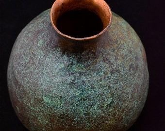 Raised copper vessel.