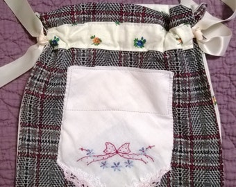 A drawstring bag made with embrodery and plaid made with upcycled materials ,make-up bag