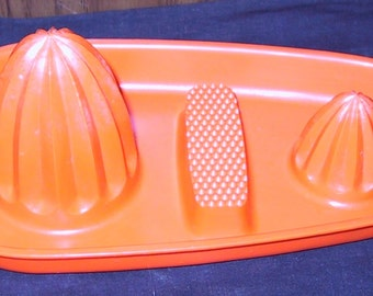 Vintage 1970's Orange Plastic Reamer