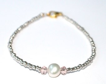 Silver seed bead bracelet with a fresh water pearl and crystal beads.