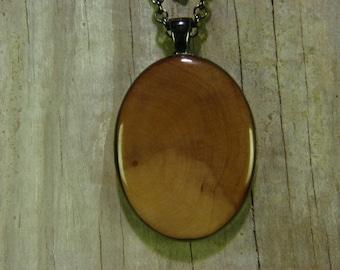 Dogwood heart wood, resin encased in gunmetal finish pendant bezel with chain
