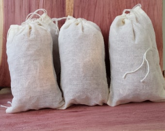 Fantastic Gift Idea 4 Cedar Sachets in Natural Muslin - approx. size: 5 x 3 x 1 inch  Made in the USA