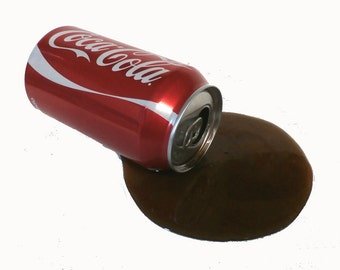 Spilled can of  coke makes a great gag gift ships free in the us