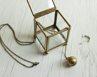 ball locket necklace in vintage brass, globe design