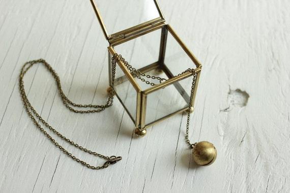 ball locket necklace in vintage brass, globe design