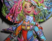 Colorful, fiber sculpted whimsical cat fairy with Laurel Burch fabric