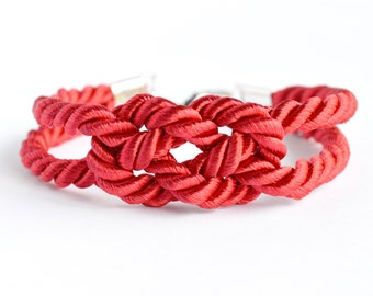 Shiny red double infinity knot nautical rope bracelet with silver anchor charm