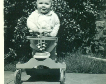Happy Baby Sitting on Stroller Walker 1940s Vintage Black White Photo Photograph