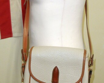 Authentic Ivory Dooney and Bourke Equestrian Purse with Brass Toggle, Brown Leather Trim, Adjustable Leather Shoulder Strap