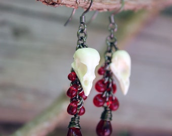 seven drop mini sparrow skull earrings