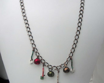 Antiqued Copper Plated Necklace with bells and small button dangles with seed beads