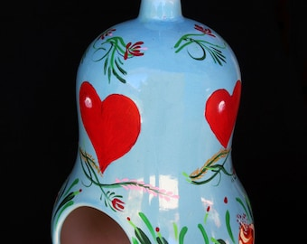 BLUE HEAVEN BIRDHOUSE, A Hand Decorated Glazed Ceramic Birdhouse With Pennsylvania Dutch Design