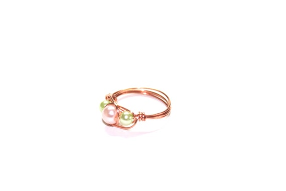 Pearl beaded ring in pastel orange and light green, copper wire wrapped, any size