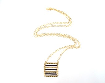 Gold and black 7 bars necklace