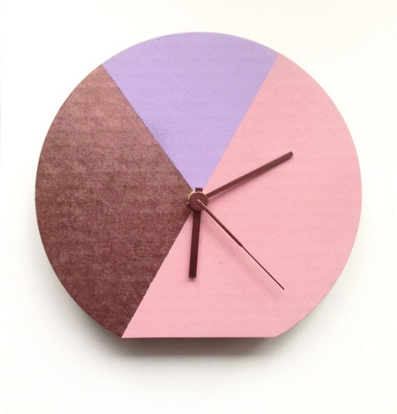 Pastel pink, lilac and copper coloured recycled cardboard geometrical eco sustainable wall and desk clock