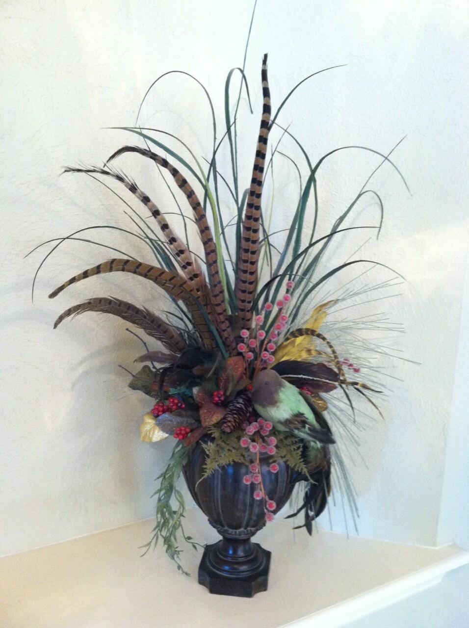 Silk floral arrangement with feathers bird