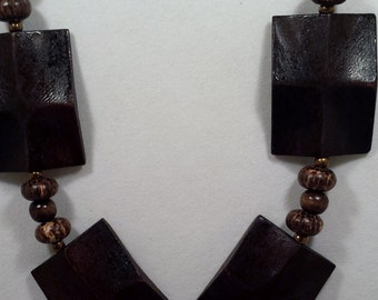 Brown wood beaded necklace and earring set.