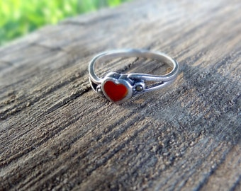 Silver ring with a red heart