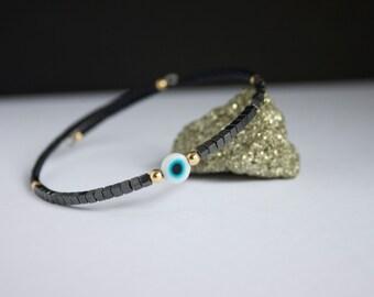 Evil eye bracelet.Hematite.Gold filled beads.beaded bracelet.