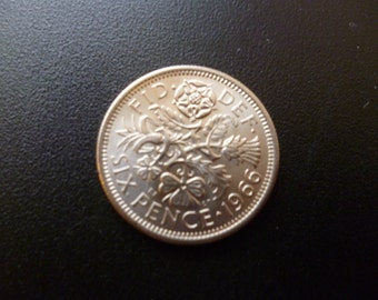 United Kingdom 1966 Sixpence coin in extremely fine condition ideal for craft or jewellery making.