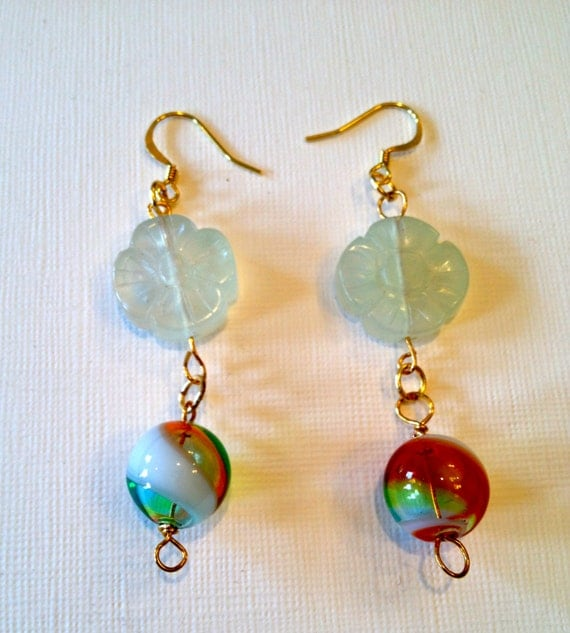 Earrings with mutlicolors round glass bead and a white flower translucent glass bead.