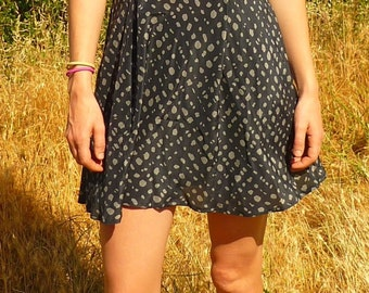 Sleeveless blue dress with polka dots