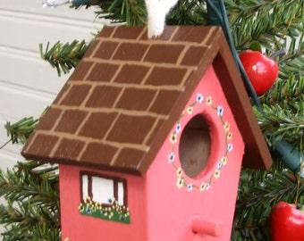 Decorative birdhouse in coral
