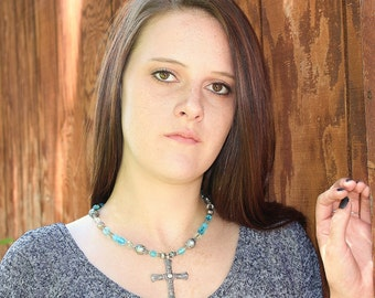Silver cross on a 18 inch blue beaded necklace