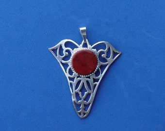 Pendant made from vintage silver plated candy dish.  A red jasper bead adds color.
