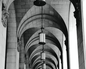 striking black and white architectural photo, arches, perspective, neoclassical columns