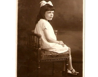 Antique French Real Photo Postcard of a little girl .