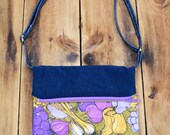 Zsuzsanna. Medium fold over cross body handbag. Adjustable strap and size.