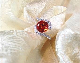 Padparadscha Sapphire Bypass Ring or Engagement Ring With White Topaz in White Gold and Sterling Silver