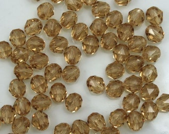 Swarovski 5025 4mm Light Colorado Topaz Round Faceted Bead