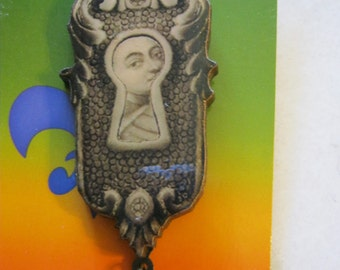 Keyhole Milagro Eye And Scary Mummy Face Wood Brooch