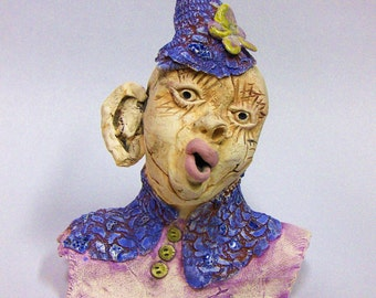 small handmade porcelain figurative funny face sculpture