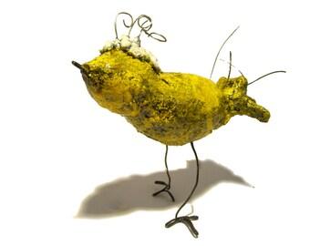Yellow grandma bird sculpture.