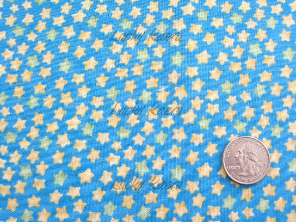 Sale clearance wind it up star fabric blue half yard for Star fabric australia
