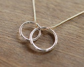 Fine silver overlapping rings on gold filled chain