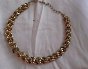 vintage Kramer gold tone twisted chain with inter woven bead.