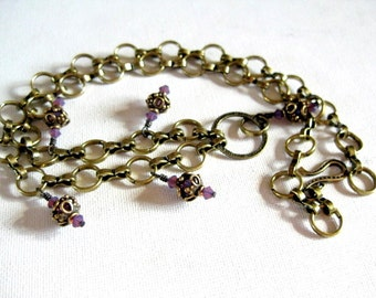 "24"" Antiqued bronze and orchid purple crystal charm necklace"