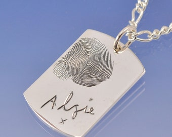 Fingerprint dog tag. A custom sterling silver pendant with your print on.