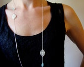 Long loop necklace in sterling silver with lace and aquamarine accents