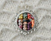 Necklace, Silver Tone Round Filigree with Photo of Yarn Store on Metallic Paper, Covered with Domed Resin by artist J. L. Fleckenstein