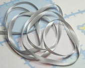 LT. SILVER DouBLe FaCeD SaTiN RiBBoN, Polyester 1/4 inch wide, 5 Yards
