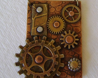 Steampunk mixed metal jewelry necklace pendant.