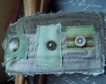 Green Textile Cuff with 3 Brown, Tan Buttons