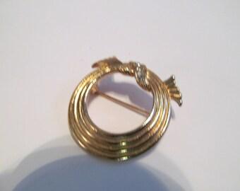 rhinestone circle  avon brooch
