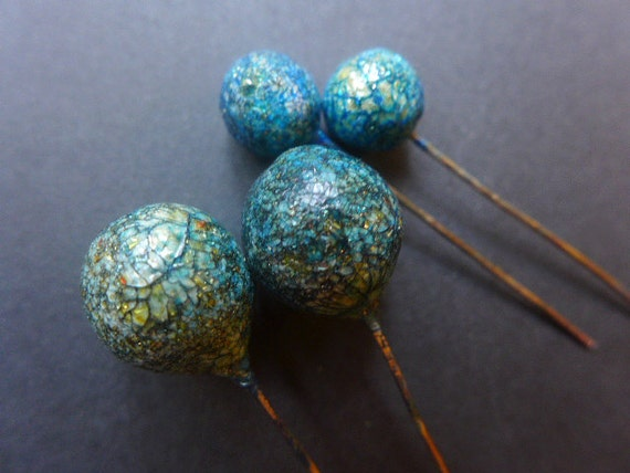 Crusty Crackle Pins. 4 lollipop polymer clay artisan head pins in blue with gold glitter shards.